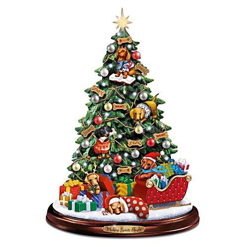 Farandole de teckels sous l'arbre de Noël