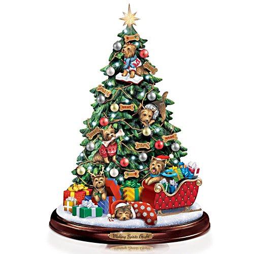 Farandole de chiots sous l'arbre de Noël