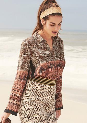 Блузка в сочетание узоров